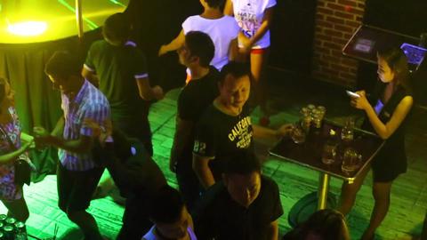 joyful people dance on nightclub floor by stage Footage