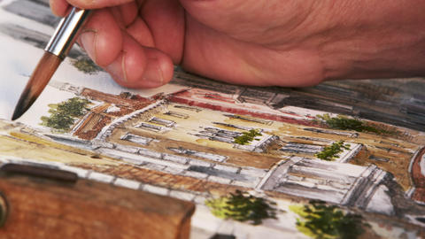 Close up shot of artist painting with watercolors a scene of a gondola on a cana Footage