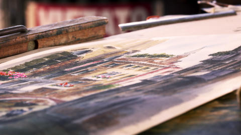 Close up shot of artist painting in details in a watercolor painting Footage