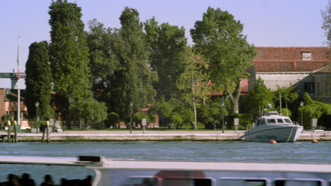 Tight panning shot of the east side of Giudecca from across the canal at a marin Footage