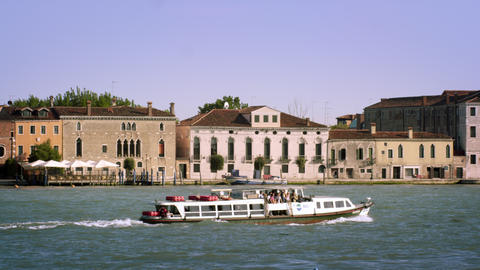 Tight panning shot of the Giudecca from across the canal Footage