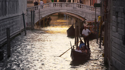 Downward slow motion tilt shot of focusing on a gondolier in Venice, Italy Footage