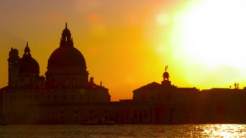 Slow motion, sun lens flare with Santa Maria della Salute in the setting sun Footage