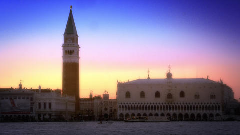 Slow motion shot of the setting sun sky behind Doge's Palace and Marco Tower Footage