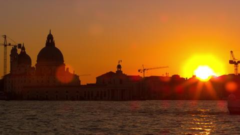 Lens flare shot of setting sun with the Santa Maria della Salute Footage