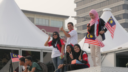 Muslim at independence day smile and wave flag,Kuala Lumpur,Malaysia Footage