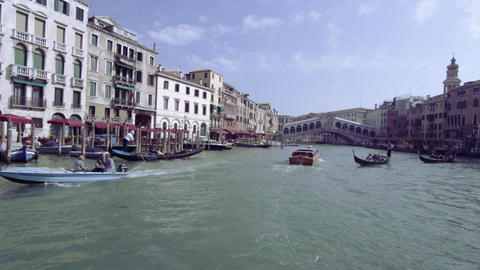 Business on the Grand Canal with Rialto Bridge int the background Footage