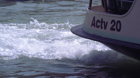 Slow motion, close up shot of the turbulent water created by the ferry's propell Footage