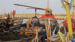 Men Unloading Small Bright Colored Boat,Ceribon,Indonesia stock footage