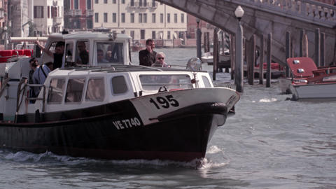 Slow motion footage focusing on a ferry as it navigates up the Grand Canal Footage
