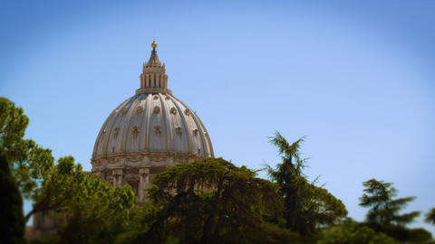 Shot of the Vatican dome from a distance looking through trees Footage