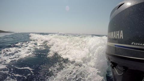 Side of outboard motor boat engine POV Live Action