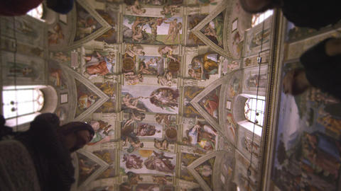 Slow motion shot of silhouetted figures in the Sistine Chapel Footage