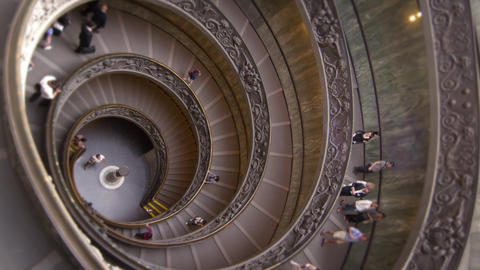 Vertical rotating shot of large spiral staircase in slow motion Footage