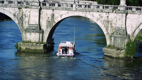 Barge passes under arch of Ponte Sant'Angelo Footage