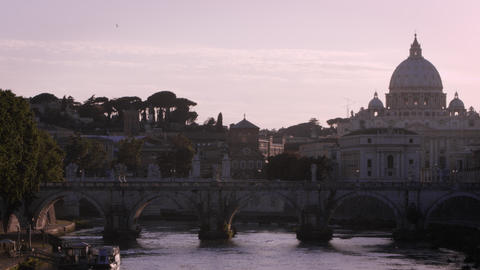 Panning footage of the dome of St. Peter's Basilica from a bridge on the Tiber Footage