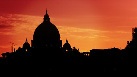 St Peter's Basilica silhouetted against a sunset Footage