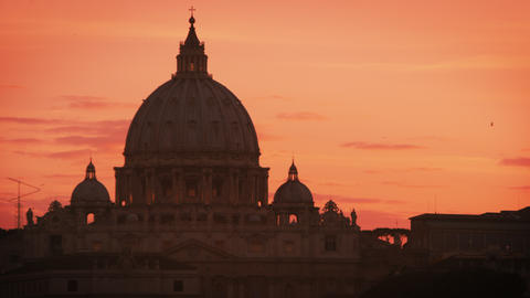 Close up footage of dome of St. Peter's Basilica as the sun sets Footage
