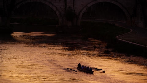 Footage of rowing boat underneath bridge on the Tiber River Footage