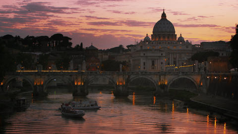 Slight left-to-right pan of Ponte Sant'Angelo and dome of St. Peter's Basilica Footage