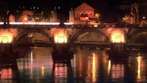 Left-to-right pan of illuminated Ponte Sant'Angelo at night Footage