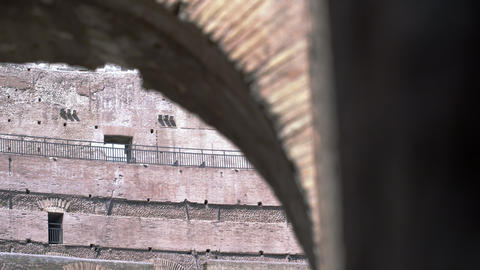 Footage focused on a top corner of an arch in the stands of the Colosseum Footage