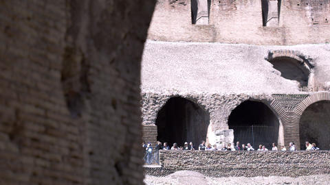 Footage focused on a side of an arch in the stands of the Colosseum and the tour Footage