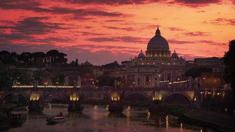 Tilt down to St. Peter's Basilica and Ponte Sant'Angelo against blue sunset Footage