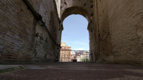 Italian buildings seen through a Colosseum arch on a sunny day Footage