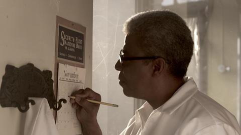 Man writing something on a calendar Footage