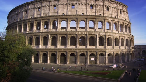 Slow motion upward tilt shot from the street to the Colosseum Footage
