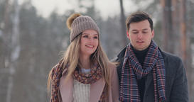 Happy Couple is Playing Winter Game Outside Enjoying Sunlight and Warm Winter Footage