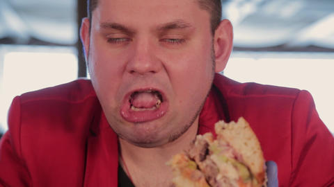 Fat man is ugly eating a big burger Footage