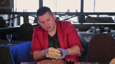 A man takes a burger and tastes his tongue Footage