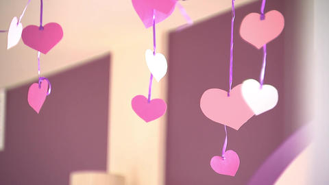 Paper hearts dangle on ribbons, Valentine's day, indoors Stock Video Footage