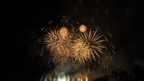 Slow motion red, white and yellow fireworks show Footage