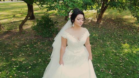 Beautiful bride in a city park park Footage