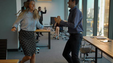 Happy business team celebrating with dance Footage