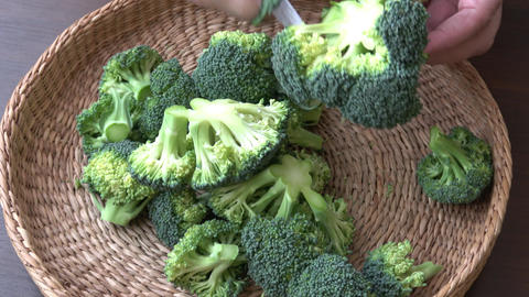 Healthy green organic raw broccoli ready for cooking Live Action