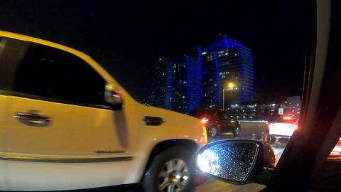 White limousine in a traffic jam in Miami at nigh ライブ動画