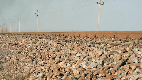 distant view of the iron rails for trains in the middle of the steppe Archivo