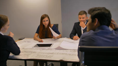 Architects Working On a Project With Blueprints Live Action