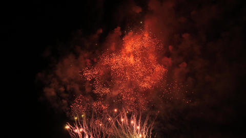 Slow motion fireworks show red, green and white Footage