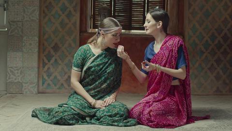 Admired females in sari smelling fragrant sachet Live Action