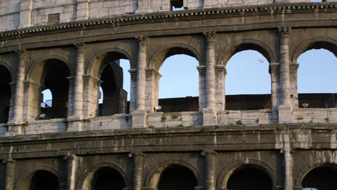 Close pan of arches in Roman Colosseum Footage