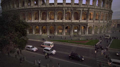 Cars and buses on street in front of Colosseum and Constantine's Arch Footage