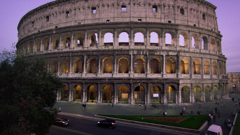 Tilt up to illuminated Colosseum during the evening Footage