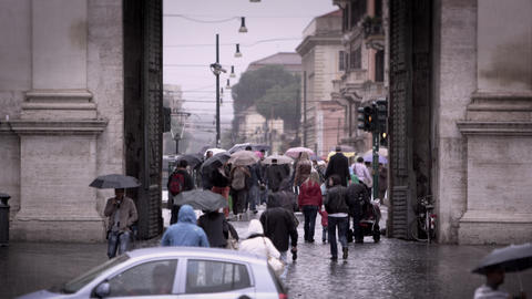 Tourists exiting and entering the Piazza del Popolo Footage