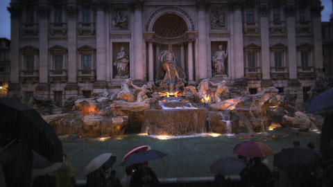 Tourists visiting the Trevi Fountain at dusk in the rain Footage