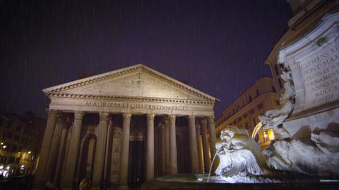 Diagonal shot from obelisk and fountain to Pantheon at night Footage